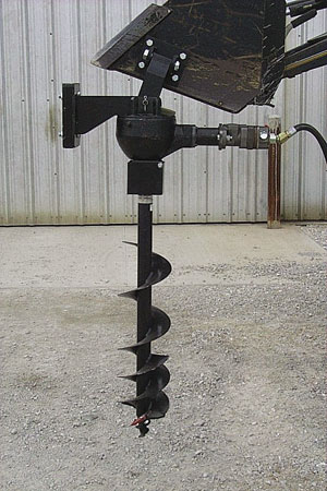 Bolt-on hydraulic post hole diggers.