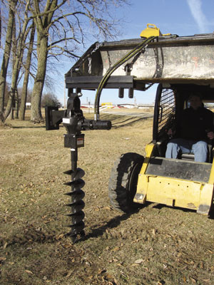 Clamp-on hydraulic post hole diggers.