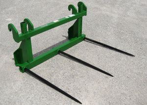 Triple bolt-in forged bale spears for larger rectangular bales.