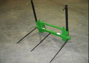 Hay attachment with triple bolt-in forged spears.