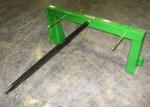 Hay attachments with single bolt-in forged bale spears.