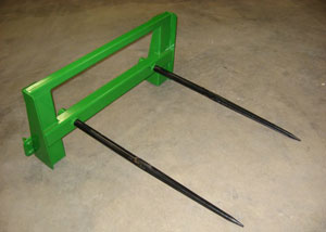 Dual bolt-in forged bale spears.