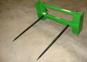Hay attachment with dual bolt-in forged spears.