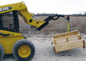 Skid Steer Crane boom for lifting and moving objects on the job site.