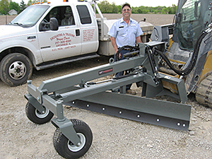 Wayne Davis and his Worksaver skid steer grader blade.