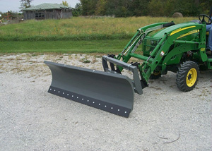 Snow blades for tractor front loaders.