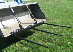 Clamp-on bucket triple bale spears for large square bales.